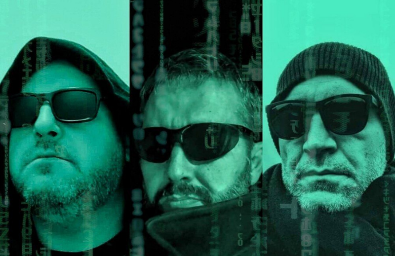 media literacy  image of 3 faces wearing dark glasses, colored in green, with falling characters, as in The Matrix movies.